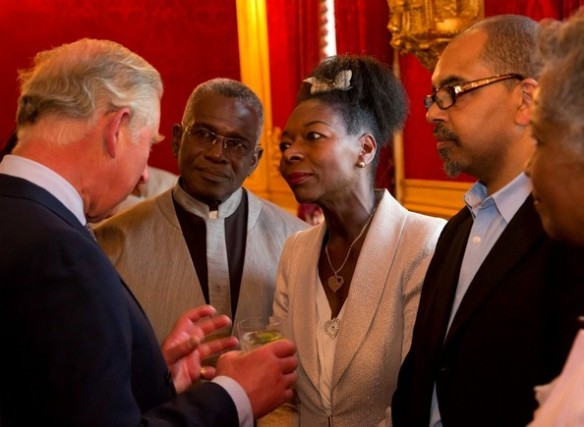 Prince Charles chats to guests: (L-R) Rudolf Walker OBE, Baroness Benjamin OBE, and Artistic Director Gary Crosby OBE at St James' Palace, London